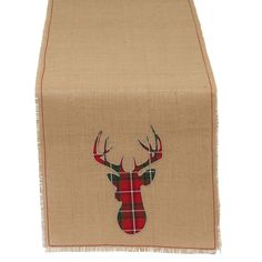Give your table some country Christmas charm with this burlap table runner. A decorative reindeer in red-and-green plaid helps you set a colorful holiday table. Material: Linen Style: Novelty, Classic More