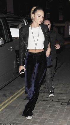 A model friend: Fellow catwalk queenCandice Swanepoel was also on the night out and flashed her tum in a cropped T-shirt and velour tracksuit bottoms