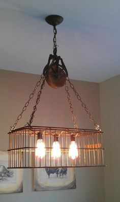 Repurposed light fixture made of vintage basket, barn pulley and Edison lamps.