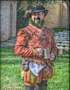 Tomato red Elizabethan Gentleman's suit, worn with a lime green linen shirt