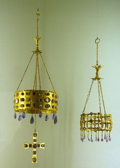Votive Crowns, Spain. From left, Crown of Suinthila and Visigothic crown (7th c.; gold, precious and semi-precious gemstones, nacre, pearls, crystals). From the Treasure of Guarrazar hoard.