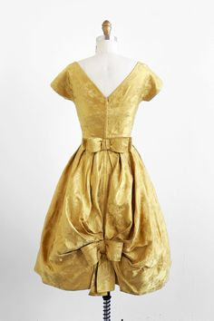 My rad fashion styling client and style guru chooses this vintage 1960's gold damask bustle back cocktail dress for me...LOVE.