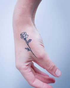 This tiny hand tattoo. | 21 Botanical Tattoo Designs You're About To Be Obsessed With