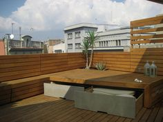 Built-in bench with storage on roof terrace