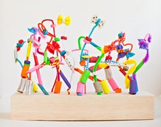 Painted pasta and pipe-cleaner creations. Stick into holes drilled into wood or use foam. or just lace onto pipe-cleaner over a tray.