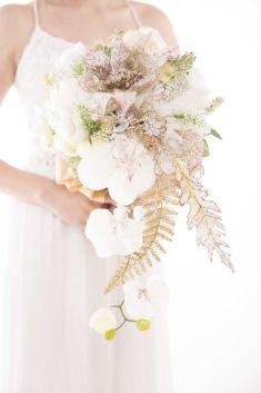 Golden leafs wedding bouquet idea | Project by LUX floral design http://www.bridestory.com/lux-floral-design/projects/glam-wedding-bouquet-2015