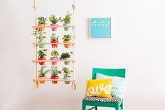 Follow this indoor garden DIY project to make a hanging vertical planter for your herbs + plants.