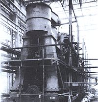 One of Titanic's massive engines lies almost complete in the Harland and Wolff machine shop.