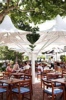 La Belle Café & Bakery is a casual yet sophisticated eatery that captures quintessential foodie flair. Located in the old barn of the Alphen Estate t. Outdoor Restaurant, Menu Restaurant, Bar Design Awards, Bars And Clubs, Cape Town South Africa, Get Directions, Light Recipes, Bakery, Patio
