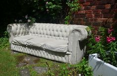 A classic three seater Chesterfield, cast in concrete for interior and exterior usage