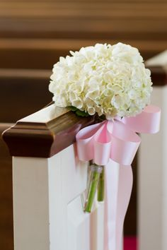 Hydrangea Pew Decoration with Pink Bow | Photography: Aaron Watson Photography. Read More: http://www.insideweddings.com/weddings/classic-virgina-wedding-inspired-by-grace-kellys-elegance/511/
