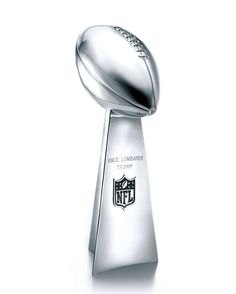 The Vince Lombardi Super Bowl Trophy: Originally designed by Tiffany for the first Super Bowl in 1967. Former Tiffany & Co. Vice President Oscar Riedener sketched the trophy's basic design on a napkin during a meeting with Pete Rozelle, then commissioner of the NFL. In 1970, the trophy was renamed for Vince Lombardi, coach of the Green Bay Packers, winners of the first two Super Bowls. (Photo: Tiffany & Co.)