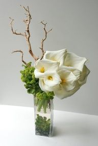 Simple and elegant modern arrangements add a wow factor to any event. They are simple in form, yet dramatic in approach.