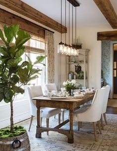 Rustic homes look tucked and this dining room certainly looks that way too. Wood is equally represented in houses, in cold and hot climates. It maintains the humidity and gives the impression of tranquility. Take a look at this chandelier that looks very old but fit perfectly in this modern dining room.