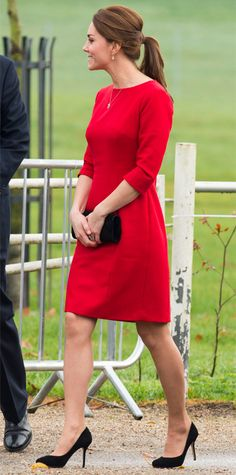 For a charity event in Norwich, England, the Duchess opted for a tomato red frock by Katherine Hooker, black accessories, and a voluminous ponytail.