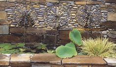 4. These sunburst mosaics frame the water spouts in a wall above a pool.