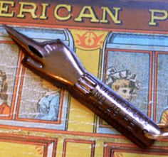 "1930s ""manicule"" or pointing/index finger pen nib."
