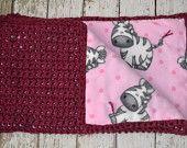 Crochet Dino Lovey Blanket, Baby Security Blanket, Toddler Security Blanket, Granny Square Blanket. $30.00, via Etsy.