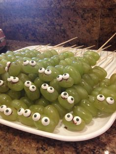 Creepy healthy Halloween snack - so awesome! Apparently the eyes are candy eyes that you can find at Walmart/Hobby Lobby