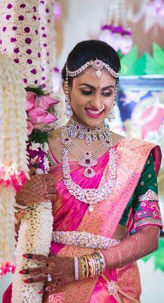 Sparkling Bride Havishya in a Bright Pink Kachivaram Saree, Deep Green Blouse and Diamond Jewelry