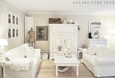 Love this room. All white except the basket and dress form; the three mirrors on the dresser; the basket under the coffee table; and the frames.