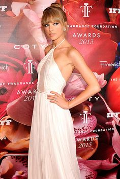 Great dress. ~ Sweet Scent: Taylor Swift worked the red carpet at Thursday night's Fragrance Foundation Awards in NYC.