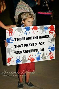 WELCOME HOME sign. These are the hands that prayed for your safe return.