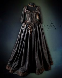 Another view of the Tituba brown silk dress.  All the amulets and details are sewn by hand.