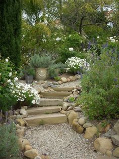 Having discussed with the builder I think we can achieve a more gentle climb to the top using a mix of sloping paths and steps on the lower level. Would be sleeper and aggregate/bark materials rather than gravel which would be a pain with the lawn.