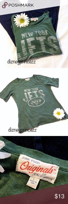 """💚 New York Jets Distressed Shirt Top Tee 🎀Thank you for visiting my closet! 🎀 Distressed Look T-shirt 💕Cotton/Polyester 🎀Armpit to armpit 20"""" / Shoulder to Hem 25"""" 🎀 I have a very clean smoke free home and will ship next day! 🎀 Only reasonable offers will be considered thank you! 🎀 I plan to follow Posh rules so please don't ask if I'll sell elsewhere or trade Thank you so much!  🎀 Please follow Posh etiquette and don't advertise on my listings and be polite 🎀 Junk Food Tops Tees…"""