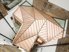 Emrys Architects extend GMS Estates' Bloomsbury offices with a copper-roofed structure that compliments the existing Georgian bricks and folds like a...