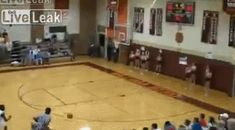 Basketball player drills a behind the back shot while dashing out the door. - http://limk.com/news/basketball-player-drills-a-behind-the-back-shot-while-dashing-out-the-door-241366324/
