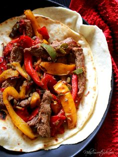 """Ingredients: 1-2 pounds of flank, skirt, or any thin steak (except carne asada, that's too thin) Sliced into 1/2"""" wide strips 1 red bell pepper, sliced into strips 1 yellow bell pepper , sliced int..."""