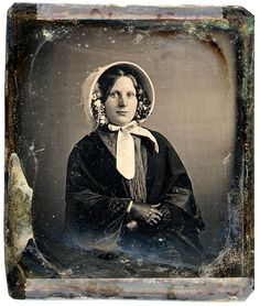 Civil War era woman, great study on flowers in her bonnet and gloves, also note her freckles