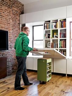 "Folding table with a rolling pedestal instead of legs.  Designed by ""noroof."""