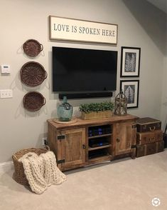 So, I shared in my stories that I made a decor switch and I'm loving it! Can you guess the change? Super easy and much… Living Room Tv, Living Room Remodel, Tv On Wall Ideas Living Room, Decor Around Tv, Above Tv Decor, Tv Stand Decor, Tv Wall Decor, Living Room Inspiration, Diy Home Decor