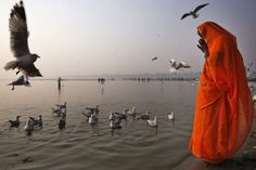 A Hindu devotee prays on the banks of the River Ganges in Allahabad, India. Allahabad, on the confluence of the rivers Ganges, Yamuna and the mythical Saraswathi, is one of Hinduism's important centers.