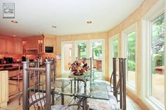 A really pretty dining room and kitchen with all new windows we installed...  Home remodeling / home improvement / renovation / large new windows