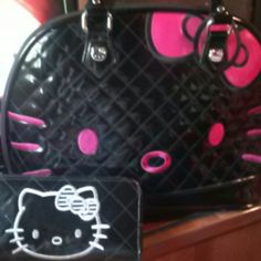 Matching purse & long wallet Matching purse and wallet!!! Both are hello kitty.... The purse is large in size and black and hot pink with hello kitty in the front and the wallet is long and matches except for its black & white in color.... Great condition!  A beautiful set for any hello kitty lover!!!! Hello Kitty Bags