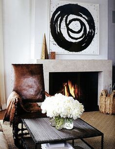 Whether balancing traditional furnishings or breaking up saturated colors, black and white art is decidedly high-impact and always chic.