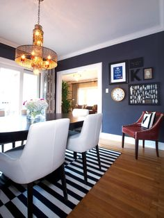 In the dining room: Navy walls, a vintage-style brass pendant light and a black and white striped rug come together here for a crisp, modern. Dining Room Blue, Dining Room Walls, Dining Room Design, Dining Chairs, Dining Area, Kitchen Dining, Navy Kitchen, Dining Table, Kitchen Nook