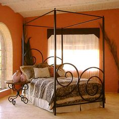 The Alexander Iron Canopy Bed from GI Designs - love the spiral design