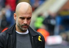 The English Football Association has fined Manchester City chief Pep Guardiola for wearing a yellow strip in help of Catalan government o...