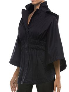 Statement-making style meets everyday practicality with our water-resistant hooded cape. The dramatic silhouette is a fresh new take on the essential jacket and has hidden interior snaps allowing you to adjust between two sizes. Slip into this sophisticated layer rain or shine, courtesy of a removable hood, for travels all over the world or closer to home.  Fabric & Details * Relaxed fit * Smooth mid-weight fabric with a touch of stretch won't wrinkle in your suitcase * Three-layer…