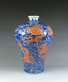 """Fine Chinese Blue and White Red Dragons Porcelain MeiPing Vase. Bright iron-red imperial five-claw dragons flying above surrounding LiShui waving water. Mark on base, six blue script -ZhuanShu- characters, QianLong Reign Period of Great Qing. 14""""H x 9-1/8""""W"""