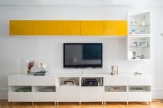 Yellow cabinetry adds a pop of sunniness to the space.