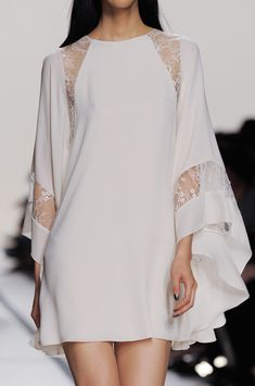 I actually really like this Elie Saab white sheer flowy sleeves short dress. It is beautiful and I love the lace! You have to really love fashion to pull this off :)