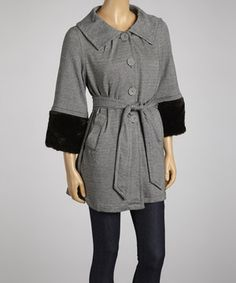 Bring on the breeze! This button-up coat will coordinate with anything in the closet while it offers up toasty warmth. The adjustable tie tapers the look for a feminine fit, while the removable fur trim dresses up the sweet style.