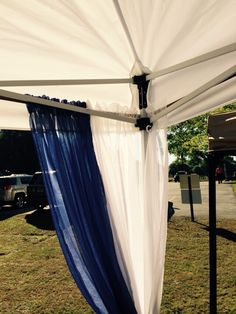The best way to hang decorative curtains to your booth! Bungee cords with hooks are threaded through the curtains and latched onto the tent.
