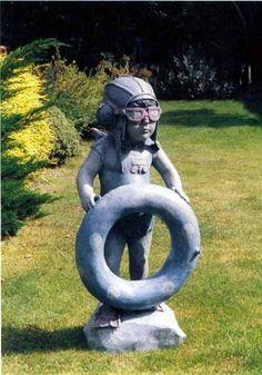 Fibreglass Sculpture of Children by artist Graham Ibbeson titled: 'Small Lifeguard (Toddler Lifeguard Little Boy sculpture/statue)'